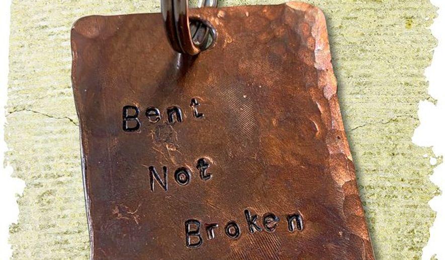 Bent not Broken Keyring illustration by Linas Garsys / The Washington Times