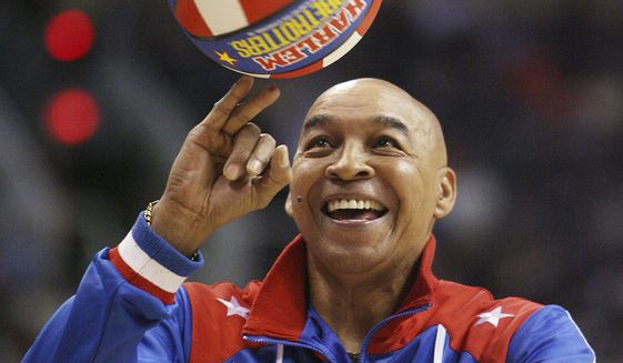 "The Harlem Globetrotters' Fred ""Curly"" Neal performs during a timeout in the second quarter in an NBA basketball game between the Indiana Pacers and the Phoenix Suns in Phoenix. Neal, the dribbling wizard who entertained millions with the Harlem Globetrotters for parts of three decades, has died the Globetrotters announced Thursday, March 26, 2020. He was 77. Neal played for the Globetrotters from 1963-85, appearing in more than 6,000 games in 97 countries for the exhibition team known for its combination of comedy and athleticism. (AP Photo/Ross D. Franklin, File)  **FILE**"