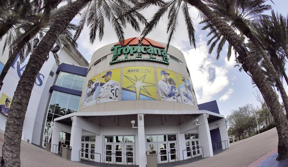 In this image taken with a fisheye lens, Tropicana Field, the home of the Tampa Bay Rays, is deserted Thursday, March 26, 2020, in St. Petersburg, Fla. Major League Baseball's regular season has been delayed in an attempt to help stop the spread of the coronavirus. The Rays were scheduled to open the season against the Pittsburgh Pirates. (AP Photo/Chris O'Meara)