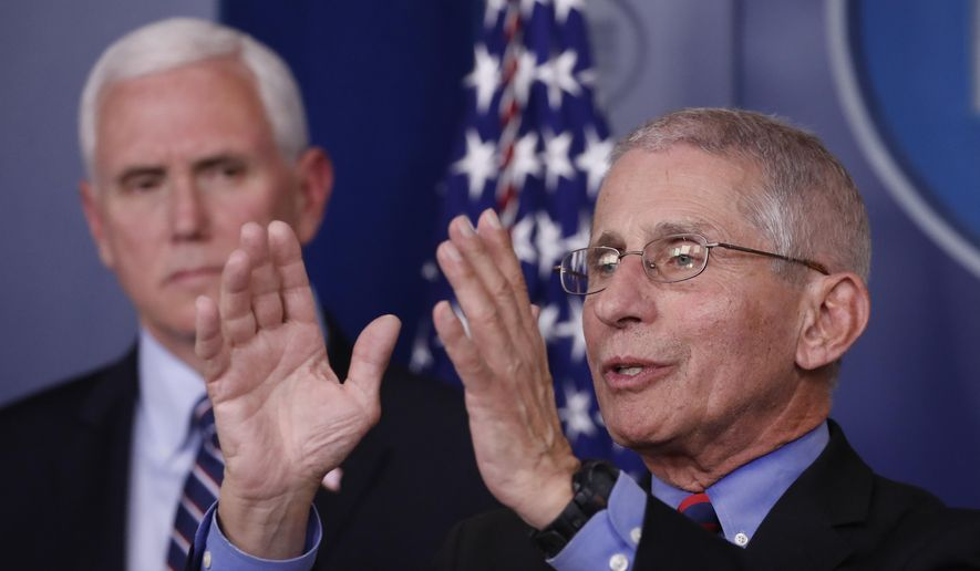 Dr. Anthony Fauci, director of the National Institute of Allergy and Infectious Diseases, speaks about the coronavirus in the James Brady Briefing Room, Wednesday, March 25, 2020, in Washington, as Vice President Mike Pence listens. (AP Photo/Alex Brandon)