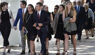 FILE - In this May 5, 2019, file photo, Thomas and Natalie Henry-Howell, third and fourth from left, arrive for the memorial service for their son, Riley Howell, one of two students killed in a campus shooting at the University of North Carolina Charlotte, in Lake Junaluska, N.C. Howell, a college student who died tackling a gunman at the university has been posthumously awarded one of the nation's highest civilian honors. Howell was honored with a Congressional Medal of Honor Society Citizen Award at wreath-laying ceremony live-streamed from Washington on Wednesday, March 25, 2020. (AP Photo/Kathy Kmonicek, File)
