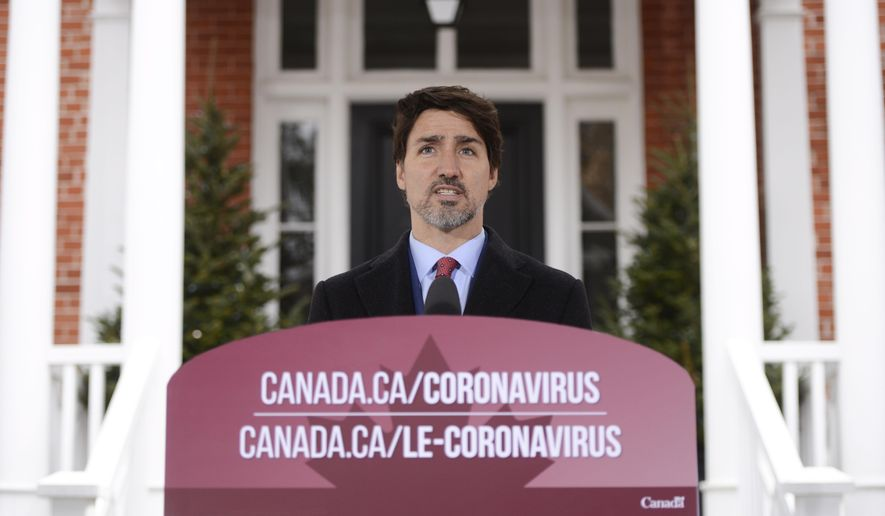 Prime Minister Justin Trudeau addresses Canadians on the COVID-19 pandemic from Rideau Cottage in Ottawa, Canada, Thursday, March 26, 2020. The new coronavirus causes mild or moderate symptoms for most people, but for some, especially older adults and people with existing health problems, it can cause more severe illness or death. (Sean Kilpatrick/The Canadian Press via AP)