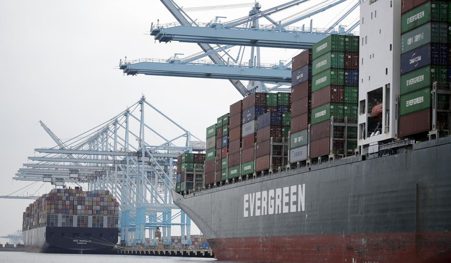 FILE - In this June 19, 2019, file photo cargo ships are docked at the Port of Los Angeles in Los Angeles. The economy grew by a moderate 2.1% in the fourth quarter of last year, but many economists believe that will be the last positive growth seen for awhile as the country endures a sharp contraction due to the impact of the coronavirus. (AP Photo/Marcio Jose Sanchez, File)