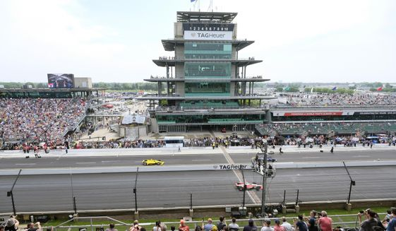 FILE - In this May 24, 2019, file photo, cars take to the track during the final practice session for the Indianapolis 500 IndyCar auto race at Indianapolis Motor Speedway in Indianapolis. The Indianapolis 500 scheduled for May 24 has been postponed until August because of the coronavirus pandemic and won't run on Memorial Day weekend for the first time since 1946. The race will instead be held Aug. 23. (AP Photo/AJ Mast, File)