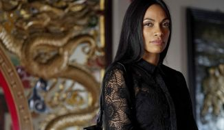 "This image released by USA Network shows Rosario Dawson, as Allegra Dill, from her new series ""Briarpatch."" Dawson plays a fashionable political fixer who returns home to her Texas border town following the bombing death of her police officer sister. (Ursula Coyote/USA Network via AP)"