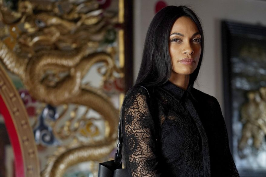 """This image released by USA Network shows Rosario Dawson, as Allegra Dill, from her new series """"Briarpatch."""" Dawson plays a fashionable political fixer who returns home to her Texas border town following the bombing death of her police officer sister. (Ursula Coyote/USA Network via AP)"""