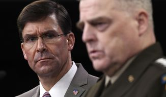 Defense Secretary Mark Esper, left, listens as Chairman of the Joint Chiefs of Staff Army Gen. Mark Milley, right, speaks during a briefing at the Pentagon in Washington, Monday, March 2, 2020. (AP Photo/Susan Walsh)