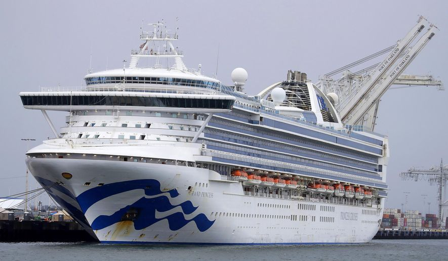 FILE - In this March 14, 2020, file photo, the Grand Princess cruise ship is docked at the Port of Oakland in Oakland, Calif. Two men who were on the coronavirus-stricken cruise ship died from the virus after being returned to California. Federal officials confirmed Thursday, March 26, 2020 that fewer than half the ship's passengers were tested for the virus, despite assurances from Vice President Mike Pence and California's governor that everyone aboard the ship would be tested. (AP Photo/Ben Margot, File)