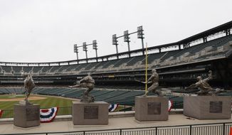 The statues of, from left, Hal Newhouser, Charlie Gehringer, Hank Greenberg and Ty Cobb stand in left field inside Comerica Park, home of the Detroit Tigers baseball team, Thursday, March 26, 2020, in Detroit. The start of the regular season, which was set to start on Thursday in Cleveland and on Monday in Detroit, is on hold indefinitely because of the coronavirus pandemic.(AP Photo/Carlos Osorio)