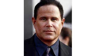 """FILE - This April 26, 2010 file photo shows actor Keith Middlebrook at the premiere of """"Iron Man 2"""" at the El Capitan Theatre in Los Angeles.  The FBI has arrested Middlebrook, who officials said falsely claimed to have developed a cure for the coronavirus and solicited investments in a company he said would market the medication. The U.S. Justice Department says in a statement that Keith Lawrence Middlebrook told his 2.4 million Instagram followers that his company would return hundreds of millions of dollars in profit.  There are no known cures or vaccinations for the coronavirus. (AP Photo/Matt Sayles, File)"""