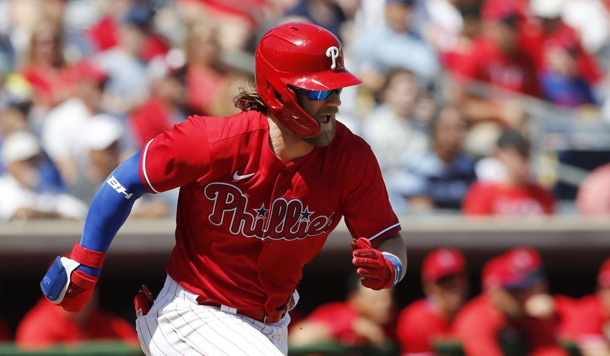 Philadelphia Phillies' Bryce Harper runs to first during a spring training baseball game against the New York Yankees, Monday, March 9, 2020, in Clearwater, Fla. (AP Photo/Carlos Osorio) ** FILE **