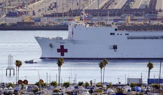 The US Naval Ship Mercy enters the Port of Los Angeles, Friday, March 27, 2020, in Los Angeles. The 1,000-bed Navy hospital ship is expected to help take the load off Los Angeles area hospitals as they treat coronavirus patients. The new coronavirus causes mild or moderate symptoms for most people, but for some, especially older adults and people with existing health problems, it can cause more severe illness or death. (AP Photo/Mark J. Terrill)