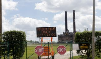 A sign indicating an arrival area for ambulances is seen outside the Ernest N. Morial Convention Center, part of which is being converted into a hospital due to the new coronavirus epidemic, in New Orleans, Friday, March 27, 2020. Officials are standing up what could be the largest hospital in the country, said Joseph Kanter, assistant state health officer at the Louisiana Department of Health. It will be built in the convention center, a sprawling facility along the Mississippi River that is generally packed with a revolving parade of conventions and conferences but is currently closed. (AP Photo/Gerald Herbert)