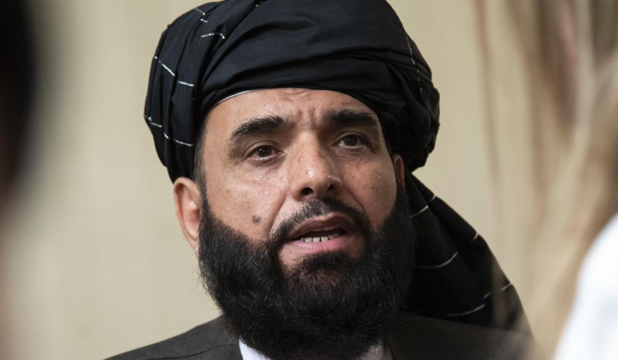 In this May 28, 2019, file photo, Suhail Shaheen, spokesman for the Taliban's political office in Doha, speaks to the media in Moscow, Russia. (AP Photo/Alexander Zemlianichenko, File)