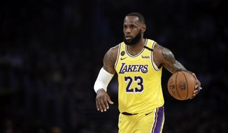 Los Angeles Lakers' LeBron James (23) dribbles during the first half of an NBA basketball game against the Brooklyn Nets Tuesday, March 10, 2020, in Los Angeles. (AP Photo/Marcio Jose Sanchez)  ** FILE **