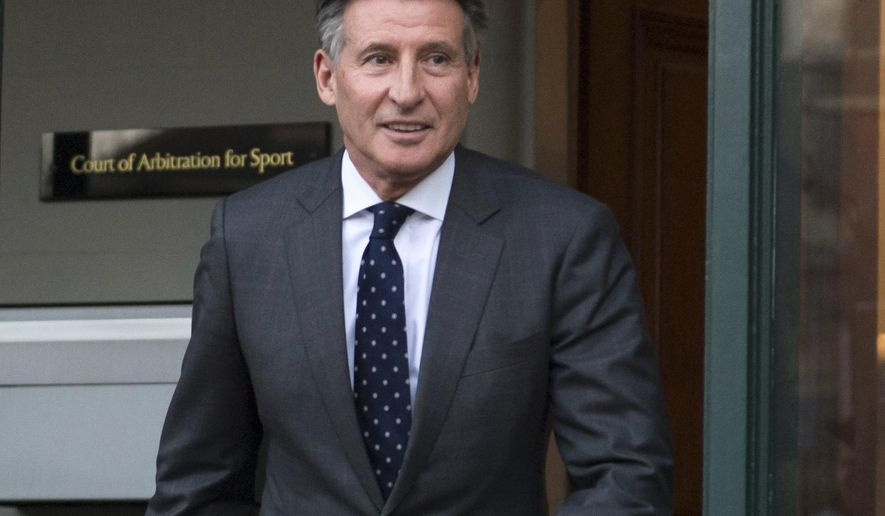 FILE - In this Monday, Feb. 18, 2019, file photo, Sebastian Coe leaves the Court of Arbitration for Sport in Lausanne, Switzerland. The date of the next world track championships is in limbo until the International Olympic Committee decides on a new schedule for the postponed Tokyo Games.Coe, the Olympic great who is now president of World Athletics, said Friday, March 27, 2020, there are plenty of options for rescheduling next year's world championships in Eugene, Oregon, but at the moment they all depend on the IOC. (Laurent Gillieron/Keystone via AP, File)