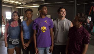 """This image released by Netflix shows, from left, Jessica Marie Garcia, Sierra Capri, Brett Gray, Diego Tinoco and Jason Genao from the series """"On My Block."""" The series is an honest portrayal of the realities young adults face growing up in inner-city Los Angeles, and critics have praised the comedy-drama's depiction of four bright, street-savvy friends with nuance and care. (Netflix via AP)"""