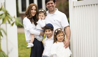 This undated image released by Maggie Hellman shows Hellman with her husband Jeremy and their three children, from left, Gili, 2, Yehuda, 7, and Elisheva, 5, at their New Jersey home. The coronavirus outbreak is having an impact on couples and their relationships. Maggie Hellman created a Facebook group for her friends to blow off their own steam. (Abbie Sophia Photography/Maggie Hellman via AP)
