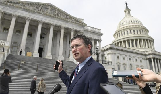 Rep. Thomas Massie, R-Ky., talks to reporters before leaving Capitol Hill in Washington, Friday, March 27, 2020, after attempting to slow action on a rescue package. Despite Massie's effort, the House, acting with exceptional resolve in an extraordinary time, rushed President Donald Trump a $2.2 trillion rescue package, tossing a life preserver to a U.S. economy and health care system left flailing by the coronavirus pandemic. (AP Photo/Susan Walsh)