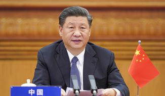 In this photo released by Xinhua News Agency, Chinese President Xi Jinping attends the G-20 Extraordinary Virtual Leaders' Summit on COVID-19 via video link in Beijing, capital of China, March 26, 2020. (Li Xueren/Xinhua via AP)