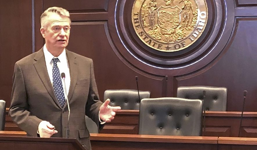 Idaho Gov. Brad Little responds to a reporter's question at the Statehouse in Boise, Idaho on Friday, March 27. Little has ordered a 1% cut in state agency spending because of the economic downturn caused by the coronavirus. The Republican governor said the 1% cutback doesn't apply to healthcare workers. He also on Friday directed the Idaho Department of Labor to make it easier for people who've lost their jobs to file unemployment claims. He also ordered a $40 million transfer of funds to fight the virus. (AP Photo/Keith Ridler)