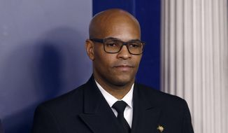 """In this March 22, 2020, file photo U.S. Surgeon General Jerome Adams attends a coronavirus task force briefing at the White House, in Washington. Chicago is among several large American cities identified as hot spots for COVID-19 infections and will see the number of local coronavirus cases rise, the U.S. surgeon general said Friday, March 27, 2020, on """"CBS This Morning."""" Adams warned that Detroit, Chicago and New Orleans """"will have a worse week next week."""" (AP Photo/Patrick Semansky, File)"""
