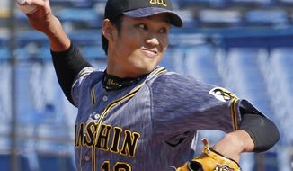 In this March 11, 2020, photo, Hanshin Tigers pitcher Shintaro Fujinami throws a ball against Yakult Swallows in a pre-season match in Tokyo. Fujinami became the first professional baseball player in Japan to test positive for the new coronavirus. Fujinami was examined at a hospital on Tuesday, March 24, and Wednesday, March 25, and a doctor recommended he have a PCR test for the new coronavirus. Kyodo News agency reported on Friday, March 27,  that the result was positive.(Kyodo News via AP)