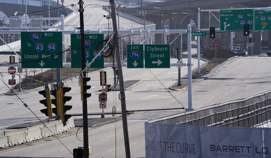 The onramp to the Hoan Bridge is void of traffic Tuesday March 24, 2020, in Milwaukee. Gov. Tony Evers issued an order Tuesday closing businesses deemed to be nonessential, ordered no gatherings of any size and placed restrictions on travel across Wisconsin for a month in an attempt to slow the spread of the coronavirus. (AP Photo/Morry Gash)