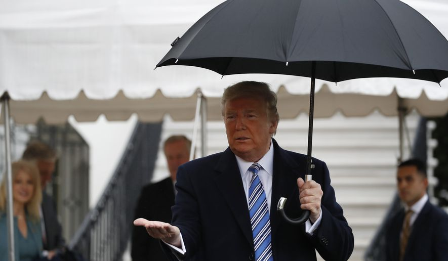 President Donald Trump stops while walking to Marine One to depart the White House, Saturday, March 28, 2020, in Washington. Trump is en route to Norfolk, Va., for the sailing of the USNS Comfort, which is headed to New York. (AP Photo/Alex Brandon)