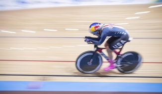 Chloe Dygert of the United States competes during the qualification race during the Cycling World Championship in Berlin, Germany, Saturday, Feb. 29, 2020. (Sebastian Gollnow/dpa via AP)
