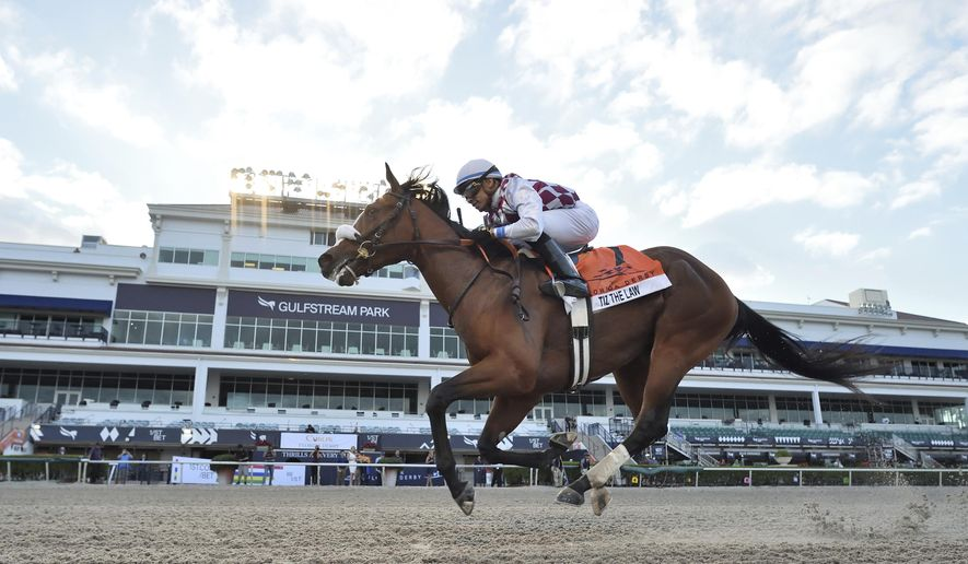 In this image provided by Gulfstream Park, Tiz the Law, riddren by Manuel Franco, wins the Florida Derby horse race at Gulfstream Park, Saturday, March 28, 2020, in Hallandale Beach, Fla. (Lauren King/Coglianese Photos, Gulfstream Park via AP)  **FILE**