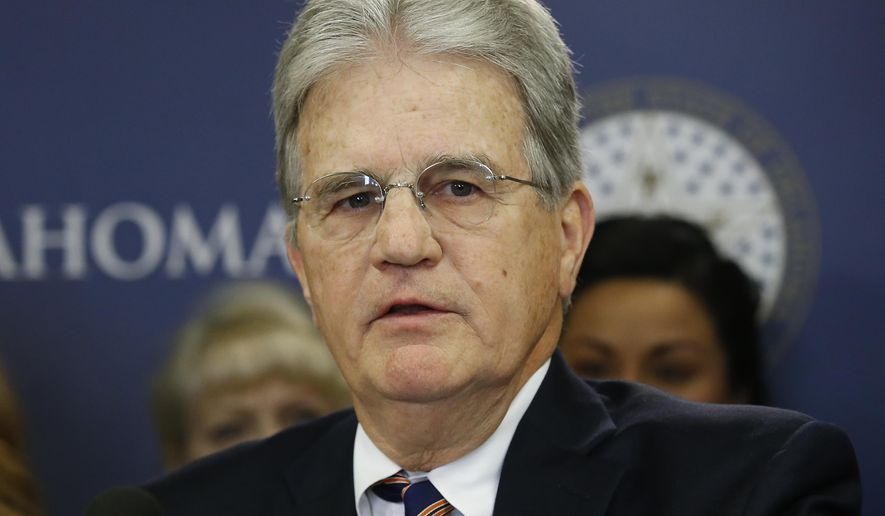 In this March 28, 2018 file photo, former U.S. Sen. Tom Coburn speaks at a news conference in Oklahoma City. Coburn died on March 28, 2020. Thanks to a 2010 provision to eliminate duplication in government-agency spending that he wrote, some $393 billion in cost savings for the federal government has been realized, according to a report published May 19 by the Government Accountability Office.  (AP Photo/Sue Ogrocki, File) **FILE**