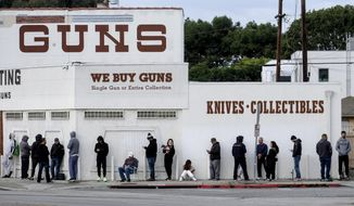"In this March 15, 2020, file photo, people wait in a line to enter a gun store in Culver City, Calif. The coronavirus pandemic has much of the world contemplating an existential question amid a growing number of stay-at-home orders, with only ""essential"" service providers allowed to go to their jobs. As U.S. states enact sweeping stay-at-home orders, there is lots of agreement on what's essential, but some have their own notions. A few are eyebrow raisers. Among them are guns, golf and cannabis. Most lists, being compiled by governors and others, capture the basics of what's essential. (AP Photo/Ringo H.W. Chiu, File) **FILE**"