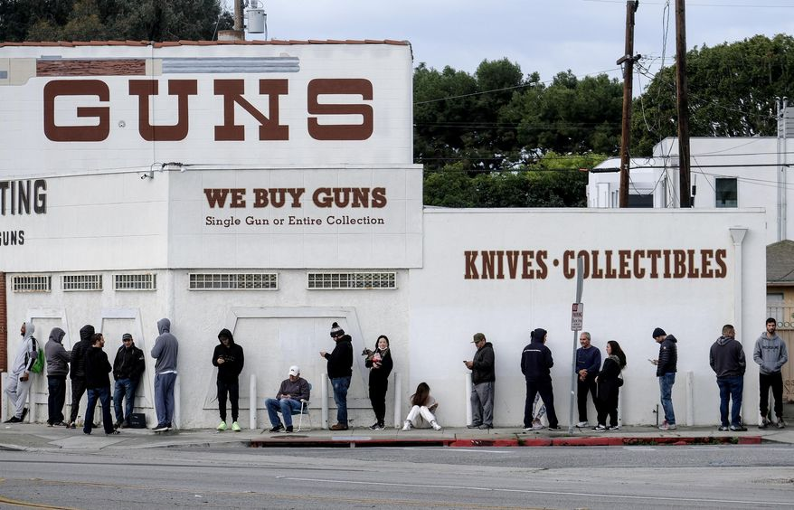 """In this March 15, 2020, file photo, people wait in a line to enter a gun store in Culver City, Calif. The coronavirus pandemic has much of the world contemplating an existential question amid a growing number of stay-at-home orders, with only """"essential"""" service providers allowed to go to their jobs. As U.S. states enact sweeping stay-at-home orders, there is lots of agreement on what's essential, but some have their own notions. A few are eyebrow raisers. Among them are guns, golf and cannabis. Most lists, being compiled by governors and others, capture the basics of what's essential. (AP Photo/Ringo H.W. Chiu, File) **FILE**"""