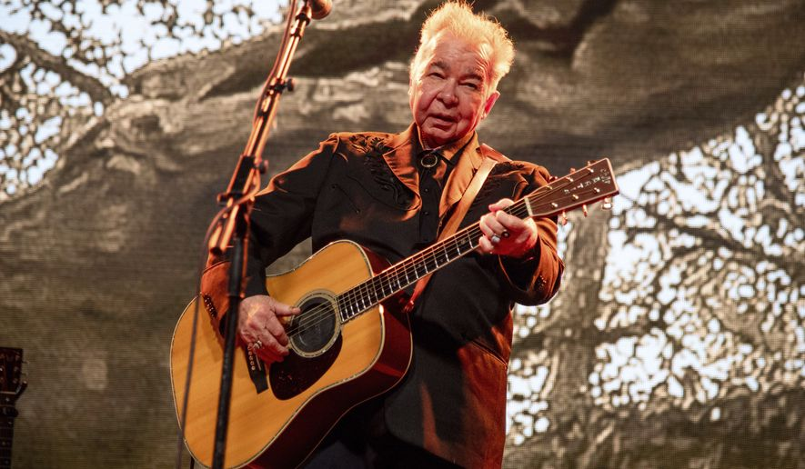 This June 15, 2019, file photo shows John Prine performing at the Bonnaroo Music and Arts Festival in Manchester, Tenn. (Photo by Amy Harris/Invision/AP, File)
