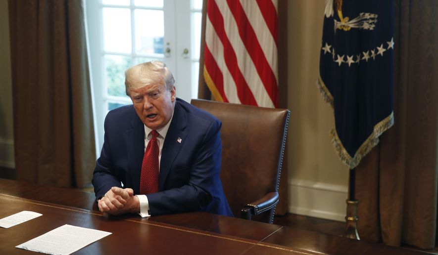 President Donald Trump speaks during a meeting with supply chain distributors in the Cabinet Room of the White House, Sunday, March 29, 2020, in Washington. (AP Photo/Patrick Semansky)