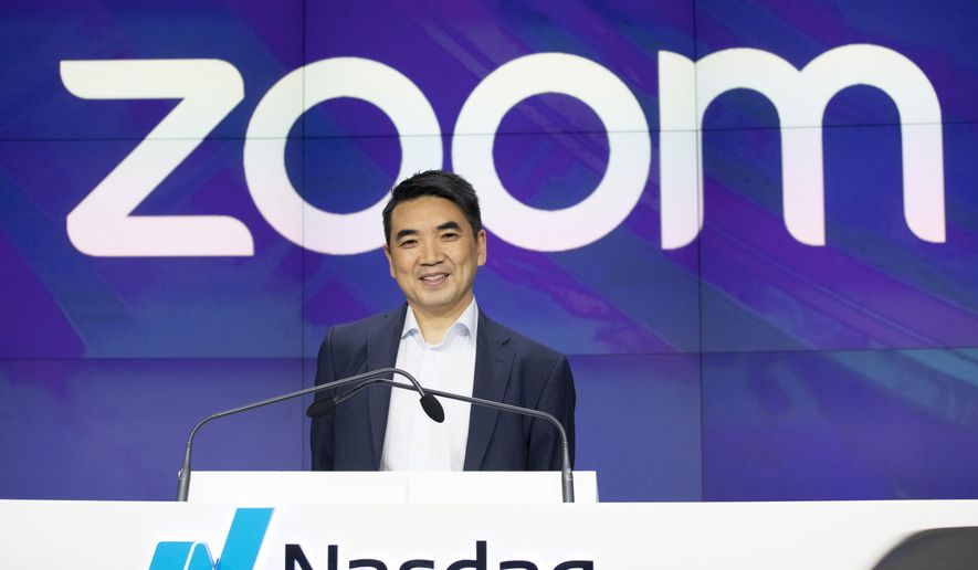 In this April 18, 2019, file photo, Zoom CEO Eric Yuan attends the opening bell at Nasdaq as his company holds its IPO in New York. Millions of people are now working from home as part of the intensifying fight against the coronavirus outbreak. Besides relying on Zoom, the video conference service, more frequently as part of their jobs, more people are also tapping it to hold virtual happy hours with friends and family banned from gathering in public places. (AP Photo/Mark Lennihan, File)