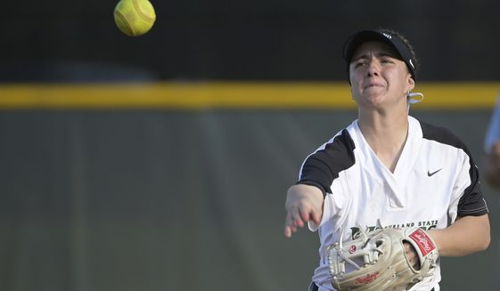 Cleveland State's Hallie Ward (4) throws to first base during an NCAA softball game against Charleston Southern, Friday, March 6, 2020, in Longwood, Fla. (AP Photo/Phelan M. Ebenhack)