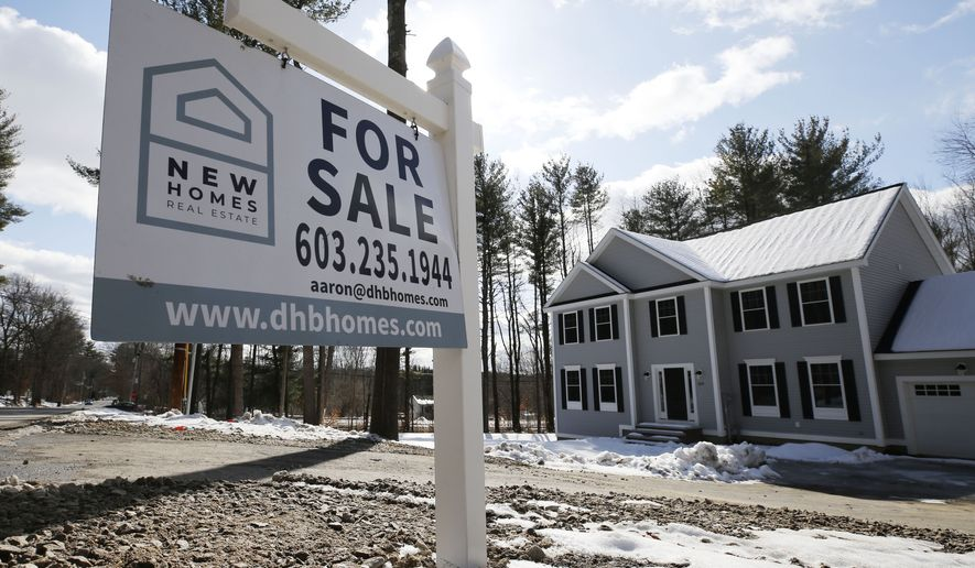 "In this Feb. 20, 2020, file photo, a ""For Sale"" sign stands in front of a newly constructed home in Londonderry, N.H. (AP Photo/Charles Krupa, File)"