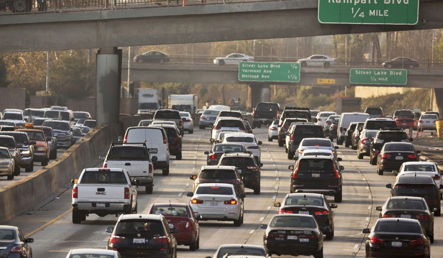 This Dec. 12, 2018, file photo shows traffic on the Hollywood Freeway in Los Angeles. The Trump administration announced new fuel efficiency standards on March 31, 2020, that roll back the aggressive plans made by the Obama administration. (AP Photo/Damian Dovarganes, File) **FILE**