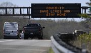 "A sign about the coronavirus is displayed over Route 50 in Davidsonville, Md., Monday, March 30, 2020. Maryland Gov. Larry Hogan issued a ""stay-at-home"" directive in response to the coronavirus effect on Monday. ""No Maryland resident should be leaving their home unless it is for an essential job or for an essential reason, such as obtaining food or medicine, seeking urgent medical attention or for other necessary purposes,"" Hogan said at a news conference on the Maryland State House lawn. (AP Photo/Susan Walsh)"