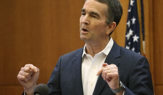 "Virginia Gov. Ralph Northam gets emotional while answering a question during a press conference, Monday, March 30, 2020, in Richmond, Va. Northam said he believed beachgoers who clustered at Virginia beaches over the weekend were ""being very, very selfish."" (Dean Hoffmeyer/Richmond Times-Dispatch via AP) ** FILE **"