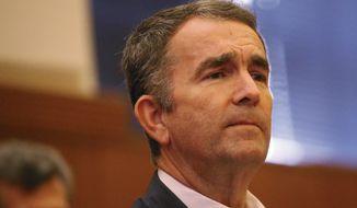 Virginia Gov. Ralph Northam listens during a press conference, Monday, March 30, 2020, in Richmond, Va. (Dean Hoffmeyer/Richmond Times-Dispatch via AP)