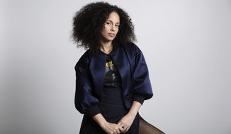 """FILE - In this Nov. 2, 2016 file photo, Alicia Keys poses for a portrait in New York. Keys' memoir """"More Myself"""" with be released on Tuesday, March 31. (Photo by Taylor Jewell/Invision/AP, File)"""