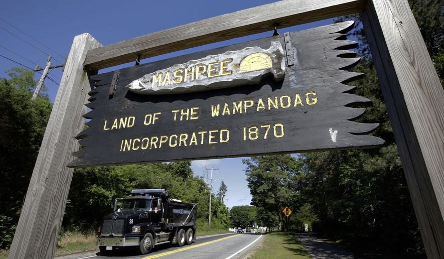 In this June 25, 2018, photo, a wooden sign advises motorists of the location of Mashpee Wampanoag Tribal lands in Massachusetts. (AP Photo/Steven Senne, File)