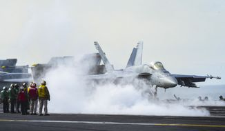 """GULF OF ALASKA (May 14, 2019) An F/A-18E Super Hornet assigned to the """"Blue Diamonds"""" of Strike Fighter Squadron (VFA) 146 launches from the flight deck of the aircraft carrier USS Theodore Roosevelt (CVN 71). (U.S. Navy photo.)"""