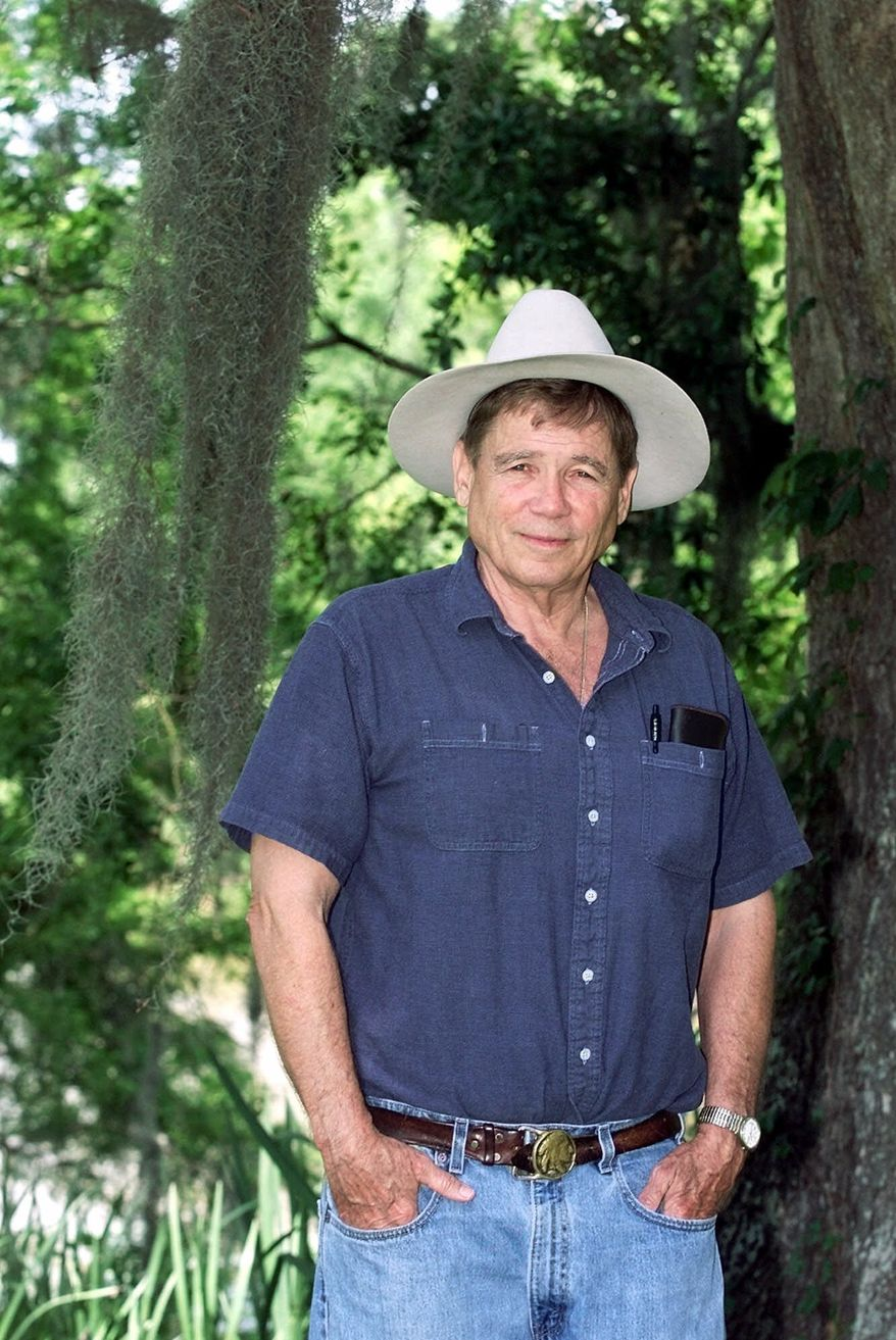 """** FILE ** Novelist James Lee Burke poses near his home in New Iberia, La., in this April 27, 2001 file photo.  Burke's new book, the 15th novel in the series featuring detective-hero Dave Robicheaux, """"Pegasus Descending,"""" is being published by Simon & Schuster.(AP Photo/Brad Kemp)"""