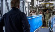 Acting Secretary of the Navy Thomas B. Modly speaks across the brow with leadership of Military Sealift Command hospital ship USNS Mercy (T-AH 19), Tuesday, March 31, 2020. Mercy deployed in support of the nation's COVID-19 response efforts, and will serve as a referral hospital for non-COVID-19 patients currently admitted to shore-based hospitals. (Petty Officer 2nd Class Natalie Byers/U.S. Navy via AP)