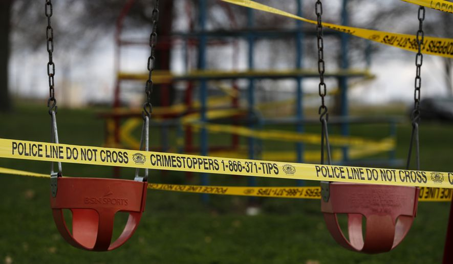 Playground equipment is wrapped in crime scene tape to prevent its use as part of the effort to slow the spread of the coronavirus Tuesday, March 31, 2020, in St. Louis. City officials are allowing the use of parks, provided proper social distancing guidelines are observed, but have closed areas such as playgrounds and basketball courts while a stay-at-home order is in effect. (AP Photo/Jeff Roberson)