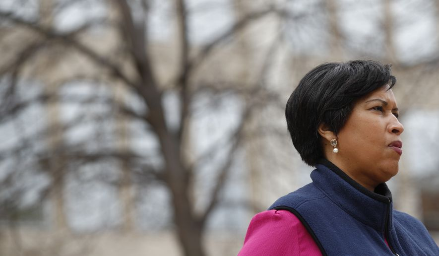 District of Columbia Mayor Muriel Bowser listens to a reporter's question during a press conference about the District's coronavirus response, Tuesday, March 31, 2020, in Washington. The District of Columbia has issued a stay-home order for all residents as the number of positive infections from the new coronavirus continue to rise. (AP Photo/Patrick Semansky) **FILE**